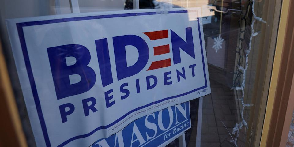 """A sign supporting Democratic presidential nominee Joe Biden hangs in the window of the Racine County Democratic Party office, during the largely virtual Democratic National Convention (DNC), in Racine, Wisconsin, U.S., August 19, 2020. <span class=""""copyright"""">REUTERS/Brian Snyder</span>"""
