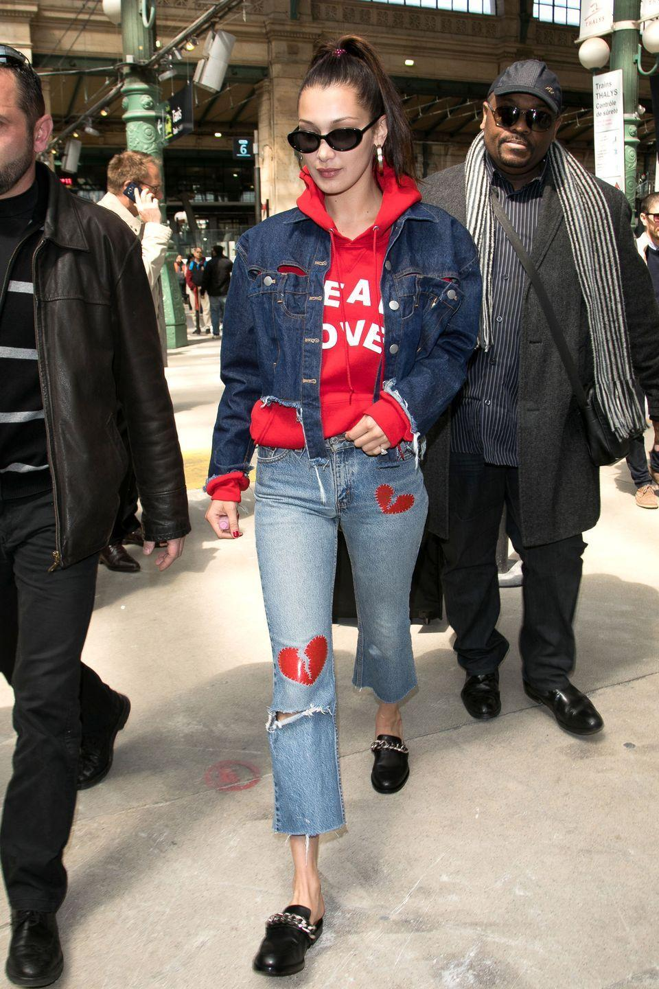 <p>In a red hoodie, cropped denim jacket, embellished cropped jeans, black leather loafer and retro rounded sunglasses while out in Paris.</p>