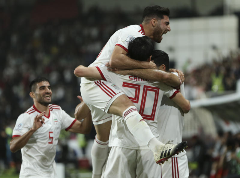 Iran's players celebrates after they scored second goal during the AFC Asian Cup quarterfinal soccer match between Iran and China at Mohammed Bin Zayed Stadium in Abu Dhabi, United Arab Emirates, Thursday, Jan. 24, 2019. (AP Photo/Kamran Jebreili)