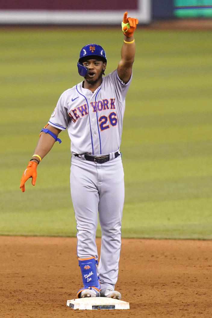 New York Mets' Khalil Lee gestures after hitting a double to score Dominic Smith during the 12th inning of the team's baseball game against the Miami Marlins, Friday, May 21, 2021, in Miami. The Mets won 6-5 in 12 innings. (AP Photo/Lynne Sladky)