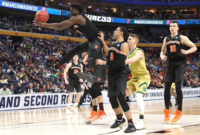 <p>Myles Stephens #12 of the Princeton Tigers rebounds the ball against the Notre Dame Fighting Irish during the first round of the 2017 NCAA Men's Basketball Tournament at KeyBank Center on March 16, 2017 in Buffalo, New York. (Photo by Maddie Meyer/Getty Images) </p>