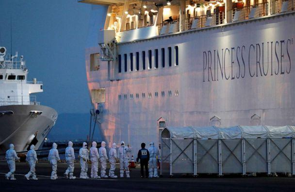 PHOTO: Officers in protective gear enter the cruise ship Diamond Princess to transfer a patient to the hospital after the ship arrived at Daikoku Pier Cruise Terminal in Yokohama, south of Tokyo, Feb. 7, 2020. (Kim Kyung Hoon/Reuters, FILE)