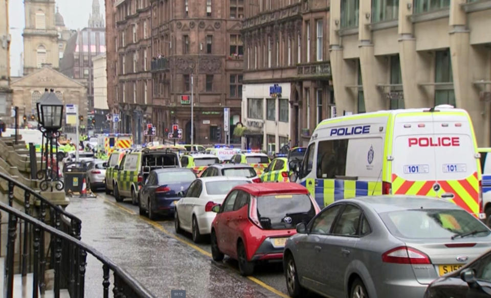 In this image taken from SKY video, emergency services attend the scene of incident in Glasgow, Scotland, Friday June 26, 2020. Police in Glasgow say emergency services are currently dealing with an incident in the center of Scotland's largest city and are urging people to avoid the area. (SKY via AP)