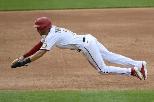 Washington Nationals' Trea Turner starts his slide to steal third base during the third inning of the first baseball game of a doubleheader against the Miami Marlins, Saturday, Aug. 22, 2020, in Washington. (AP Photo/Nick Wass)