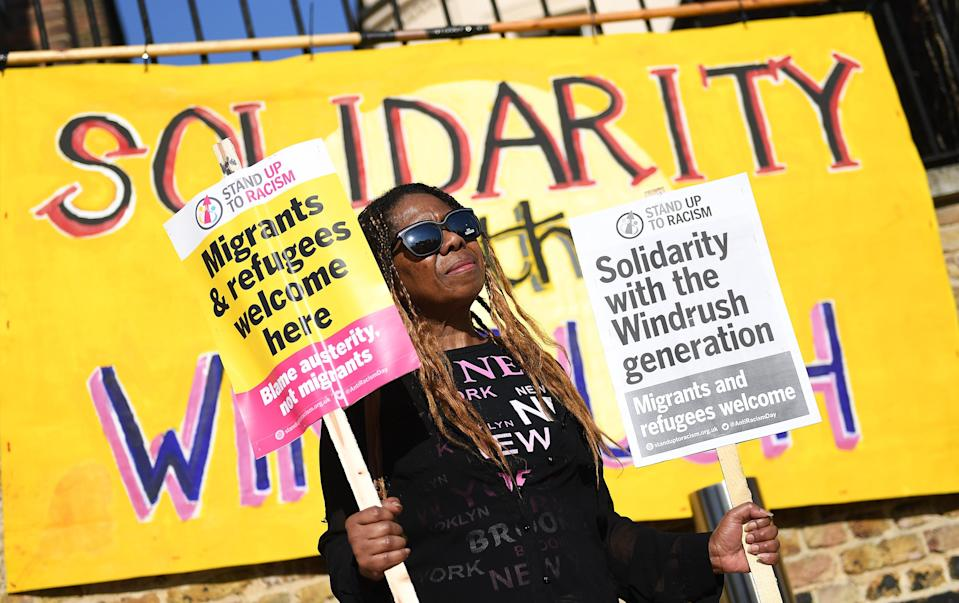 A woman gathers for a Windrush generation solidarity protest in Brixton, 20 April, 2018 (EPA-EFE)