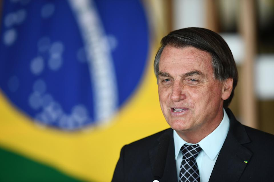 Brazilian President Jair Bolsonaro delivers a speech after holding a meeting with US National Security Advisor Robert O'Brien at Itamaraty Palace in Brasilia, on October 20, 2020. - The United States and Brazil signed three agreements Monday they said would expand and deepen their existing trade deal, the latest bonding moment under Presidents Donald Trump and Jair Bolsonaro. The new protocol adds chapters on facilitating trade, regulatory practices and anti-corruption measures. (Photo by EVARISTO SA / AFP) (Photo by EVARISTO SA/AFP via Getty Images)