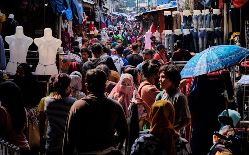 Indonesians fail to adhere to social distancing as they crowd a market in advance of the end of Ramadan - Ed Wray/Getty Images