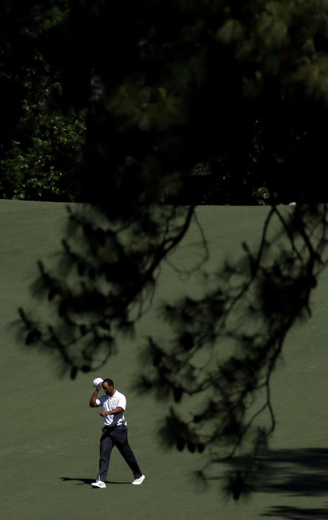 <p>Tiger Woods walks down the second fairway during the third round of the Masters golf tournament Saturday, April 7, 2012, in Augusta, Ga. (AP Photo/David J. Phillip) </p>
