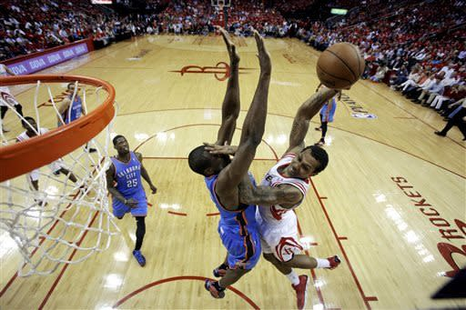 Houston Rockets' Greg Smith (4) shoots against Oklahoma City Thunder's Serge Ibaka (9) during the second quarter of Game 4 in their first-round NBA basketball playoff series Monday, April 29, 2013, in Houston. (AP Photo/David J. Phillip)