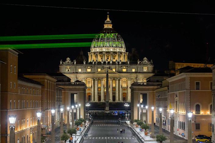 """<p>Greenpeace activists project the message """"Planet Earth First! """" on the dome of St. Peter's Basilica at the Vatican, hours ahead of the meeting between President Donald Trump and Pope Francis on May 23, 2017. (Photo: Bente Stachowske/Greenpeace via AP) </p>"""