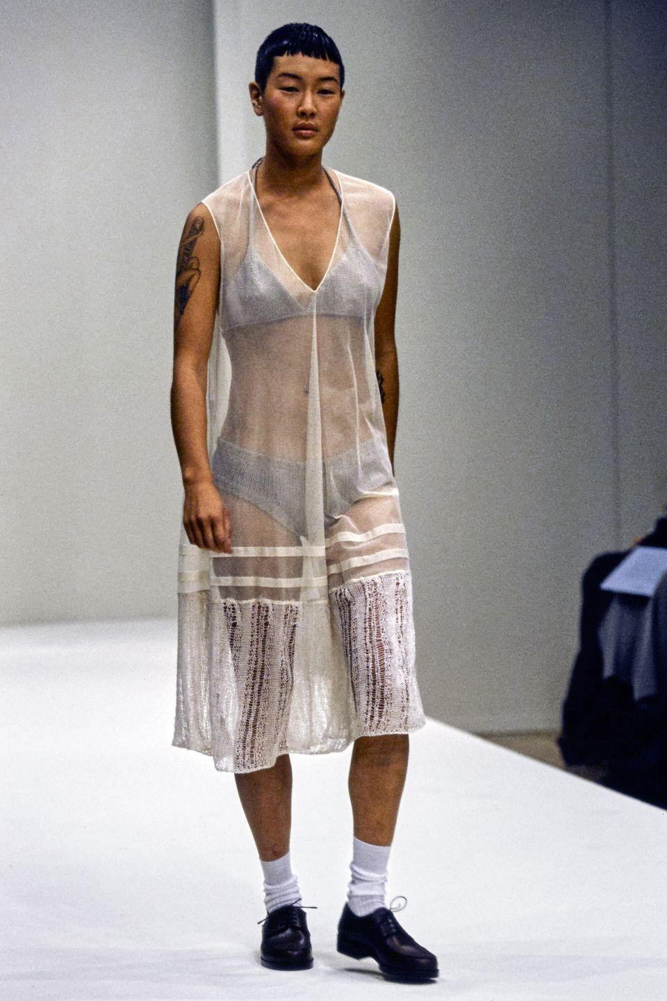 """<p>Asian, five foot seven, and an out and proud lesbian, Jenny Shimizu didn't fit into any prescribed box. Still, the California native persevered in the fashion industry, becoming the first Asian model to walk down a major runway (Prada) and star in campaigns for Calvin Klein, Hourglass Cosmetics, and Banana Republic. She's also appeared in a film alongside Angelina Jolie (whom she <a href=""""https://heavy.com/news/2016/09/angelina-jolie-lesbian-lover-girlfriend-jenny-shimizu-divorce-brad-pitt/"""" rel=""""nofollow noopener"""" target=""""_blank"""" data-ylk=""""slk:reportedly"""" class=""""link rapid-noclick-resp"""">reportedly</a> dated) and was a judge on <em>Make Me a Supermodel</em>. </p>"""