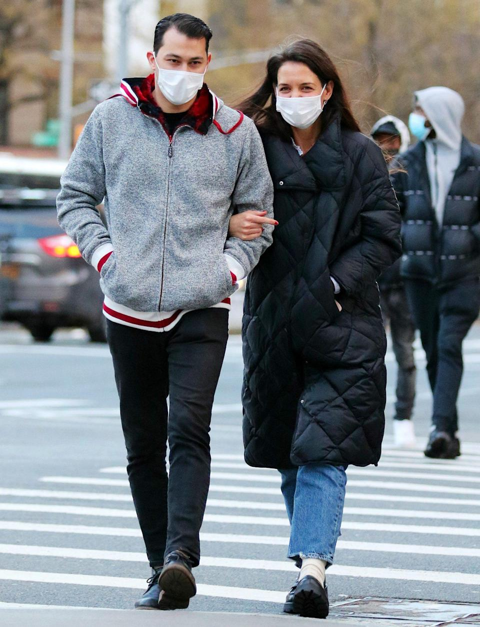 <p>Katie Holmes and Emilio Vitolo Jr. walk arm-in-arm through N.Y.C. on Sunday.</p>