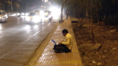 A Man Sitting on a Footpath With His Laptop Becomes a Meme