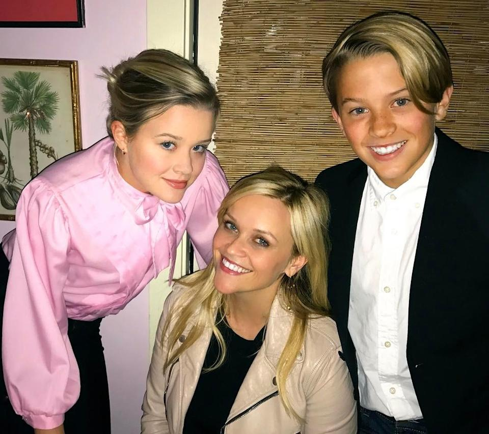 Reese Witherspoon with two of her children.