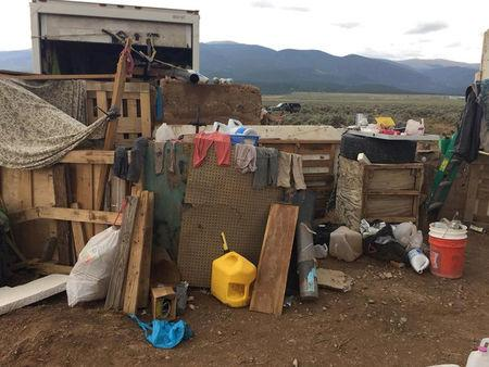 Handout photo of conditions at a compound in rural New Mexico where 11 children were taken into protective custody for their own health and safety after a raid by authorities, near Alamia, New Mexico