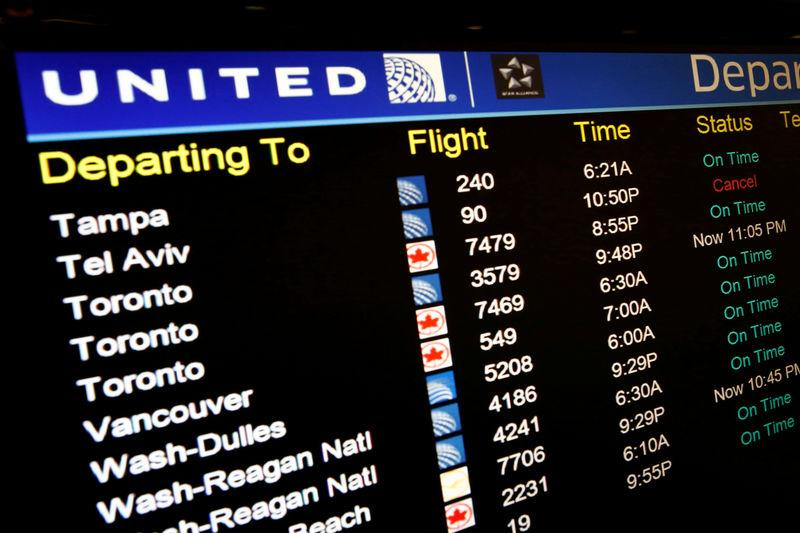 FILE PHOTO: A United Airlines electronic departure board is pictured inside the terminal at Newark International Airport in New Jersey