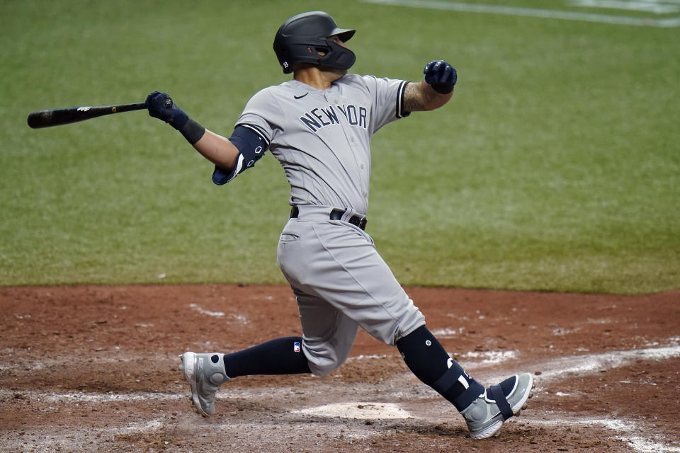 New York Yankees' Rougned Odor watches his RBi single off Tampa Bay Rays relief pitcher Collin McHugh during the 10th inning of a baseball game Sunday, April 11, 2021, in St. Petersburg, Fla. (AP Photo/Chris O'Meara)
