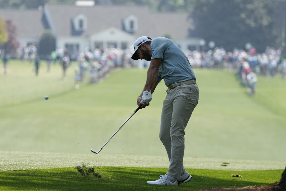 Dustin Johnson hits on the first fairway during a practice round for the Masters golf tournament on Wednesday, April 7, 2021, in Augusta, Ga. (AP Photo/Charlie Riedel)