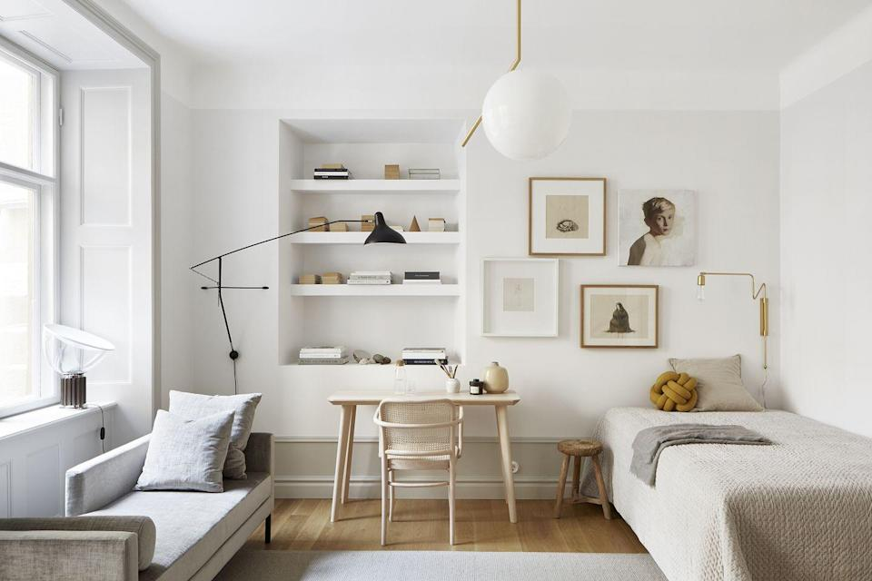 <p>Sconces and ceiling pendants are great space-savers if you need to keep surfaces and floors clear for furniture and work supplies. This swinging sconce is perfect for a room with multiple uses because you can shift it over a desk for working, then above the sofa for reading and lounging. </p>