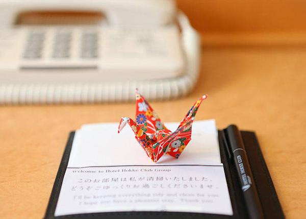 A paper crane of hospitality. They all come in different patterns and colors