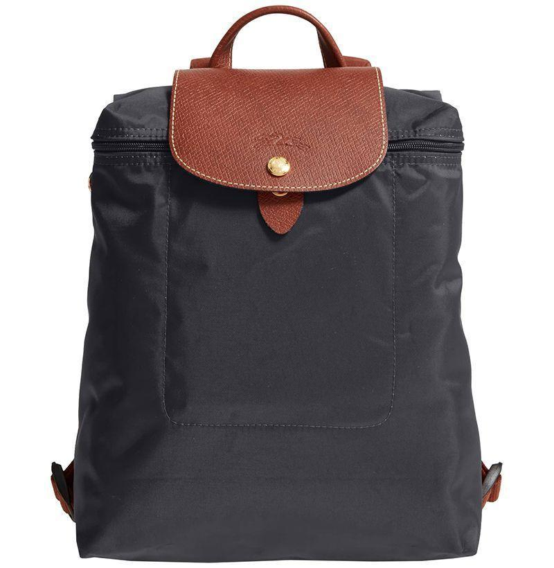 """<p><strong>Longchamp</strong></p><p><strong>$125.00</strong></p><p><a href=""""https://go.redirectingat.com?id=74968X1596630&url=https%3A%2F%2Fshop.nordstrom.com%2Fs%2Flongchamp-le-pliage-backpack%2F3023122&sref=https%3A%2F%2Fwww.esquire.com%2Flifestyle%2Fg2121%2Fmothers-day-gift-guide%2F"""" rel=""""nofollow noopener"""" target=""""_blank"""" data-ylk=""""slk:Buy"""" class=""""link rapid-noclick-resp"""">Buy</a></p><p>Longchamp's nylon backpack will get her through any kind of hectic day. </p>"""