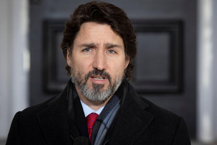 <p>Justin Trudeau at a COVID-19 briefing in Ottawa on 18 December, 2020</p> (AFP via Getty Images)