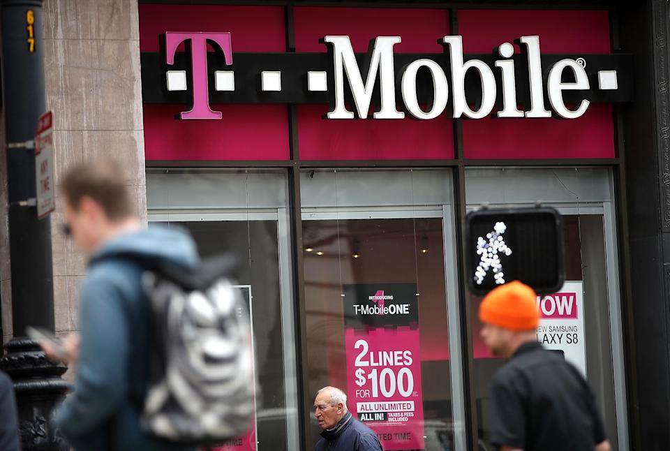 SAN FRANCISCO, CA - APRIL 24: Pedestrians walk by a T-Mobile store on April 24, 2017 in San Francisco, California. T-Mobile will report first quarter earnings today after the closing bell. (Photo by Justin Sullivan/Getty Images)