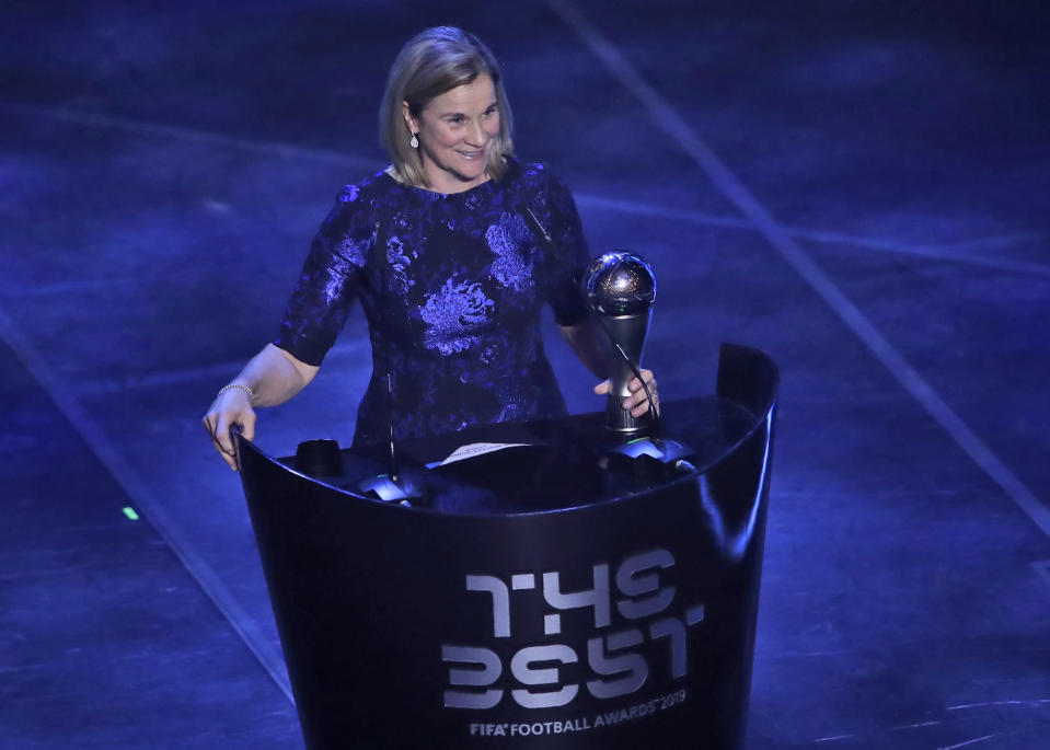 United States women's World Cup winning coach Jill Ellis receives the Best FIFA award during the ceremony of the Best FIFA Football Awards, in Milan's La Scala theater, northern Italy, Monday, Sept. 23, 2019. (AP Photo/Antonio Calanni)