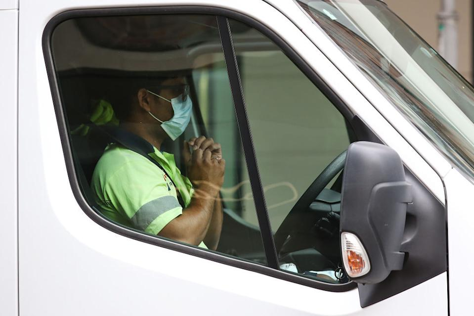 A driver wears a mask in his car in Brisbane, Australia.