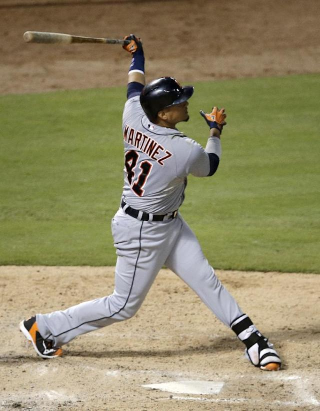 Detroit Tigers' Victor Martinez follows through on a solo home run off Texas Rangers starting pitcher Joe Saunders in the fifth inning of a baseball game, Wednesday, June 25, 2014, in Arlington, Texas. (AP Photo/Tony Gutierrez)