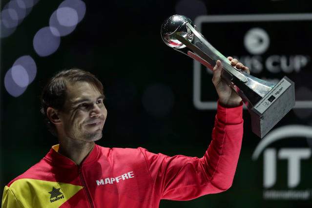 Spain's Rafael Nadal holds the tournament's best player award after Spain defeated Canada in the Davis Cup final in Madrid, Spain, Sunday, Nov. 24, 2019. (AP Photo/Manu Fernandez)
