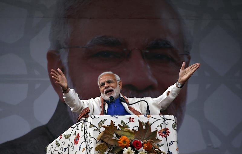 India's Prime Minister Narendra Modi addresses a rally in a cricket stadium in Srinagar, November 7, 2015. Modi pledged 800 billion rupees ($12.10 billion) in funds to bolster development and economic growth in Kashmir, a year after the worst flooding in more than a century destroyed half a million homes there. REUTERS/Danish Ismail TPX IMAGES OF THE DAY