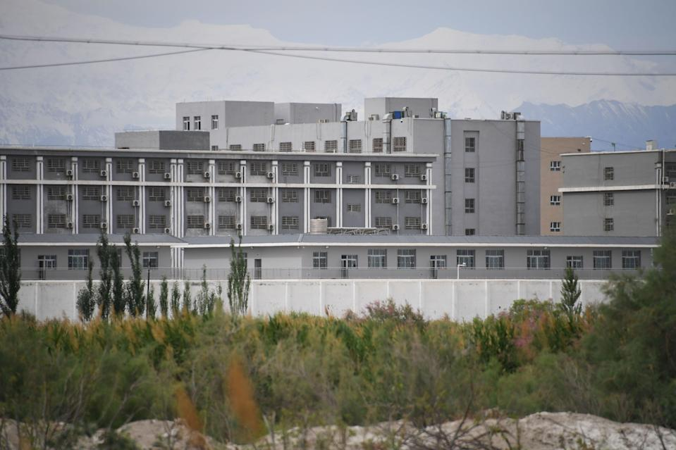 File Image: This photo taken on 4 June 2019 shows a facility believed to be a re-education camp where mostly Muslim ethnic minorities are detained, north of Akto in China's northwestern Xinjiang region (AFP via Getty Images)
