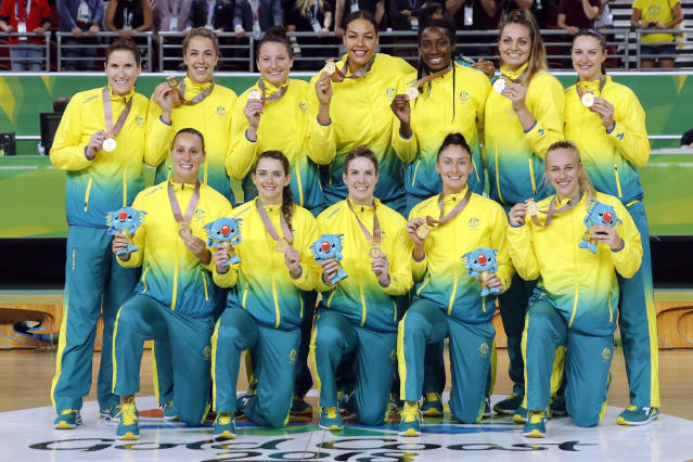 Members of Australia's women's basketball team stand with their gold medals at the Gold Coast Convention and Exhibition Centre during the 2018 Commonwealth Games on the Gold Coast, Australia, Saturday, April 14, 2018. (AP Photo/Mark Schiefelbein)