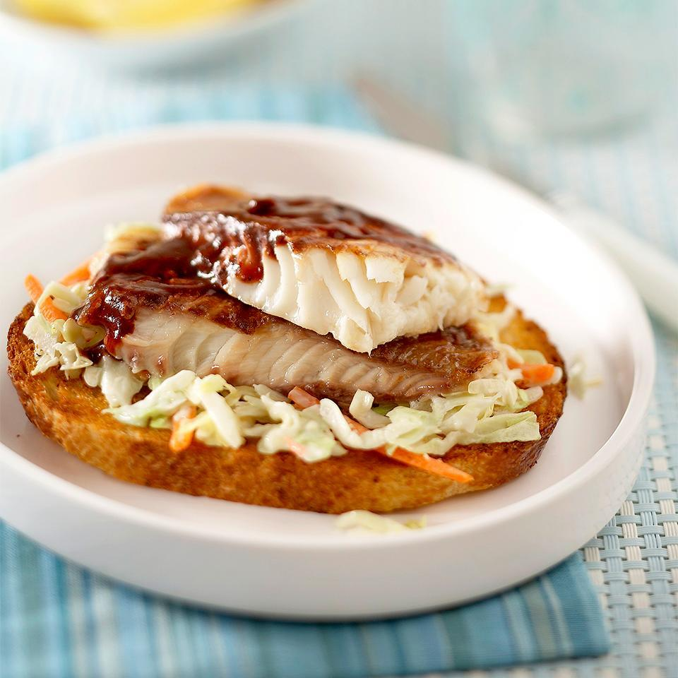<p>Grilled fish nestled on a bed of crunchy coleslaw and capped off with a drizzle of barbecue sauce makes these diabetic-friendly sandwiches sure to please.</p>
