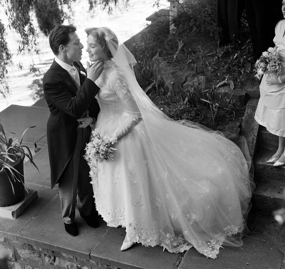 <p>Up-and-coming actress Julie Andrews married set designer Tony Walton in a traditional ceremony at St Mary Oatlands Church in Weybridge, Surrey on May 10, 1959. </p>