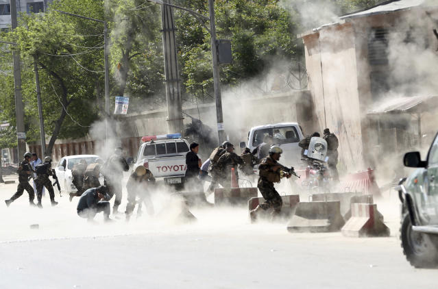 <p>Security forces run from the site of a suicide attack after the second bombing in Kabul, Afghanistan, April 30, 2018. (Photo: Massoud Hossaini/AP) </p>