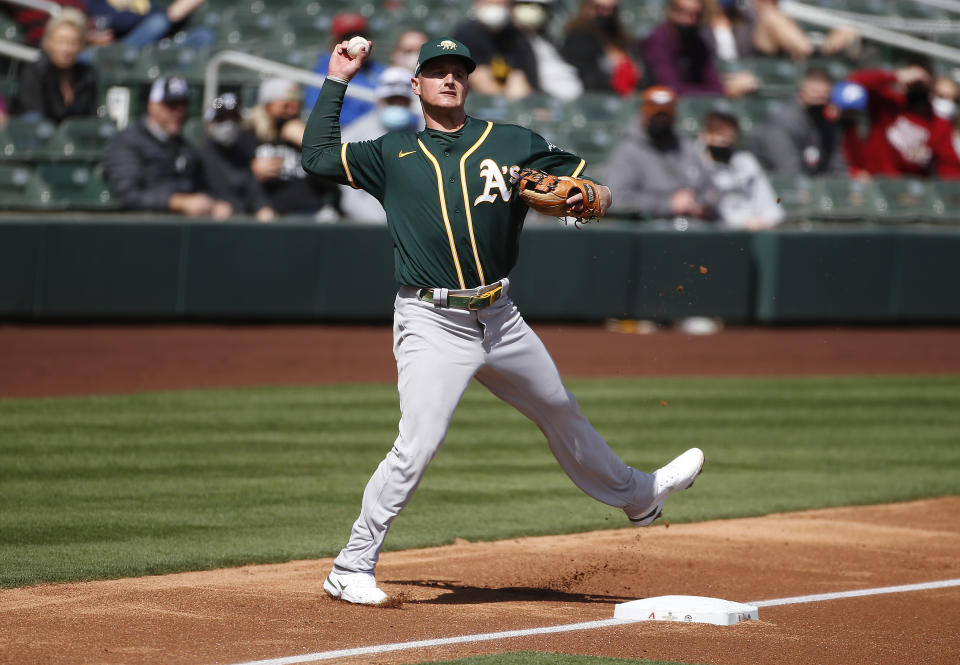 SCOTTSDALE, ARIZONA - MARCH 16: Third baseman Matt Chapman #26 of the Oakland Athletics throws to first base on a ground ball out against the Arizona Diamondbacks during the second inning of the MLB spring training baseball game at Salt River Fields at Talking Stick on March 16, 2021 in Scottsdale, Arizona. (Photo by Ralph Freso/Getty Images)