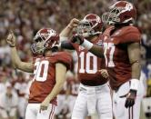 Alabama's Jeremy Shelley (90) reacts with AJ McCarron (10) and Chris Underwood (87) after making a field goal during the first half of the BCS National Championship college football game against LSU Monday, Jan. 9, 2012, in New Orleans. (AP Photo/David J. Phillip)