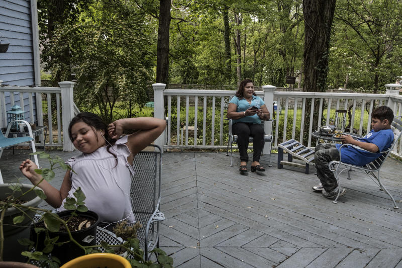Mirna with Mirna-Marely and Yosemar on the deck at Vonnette's home. (Photo: Fabio Bucciarelli for Yahoo News)