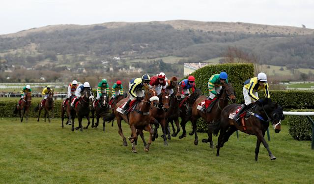 Horse Racing - Cheltenham Festival - Cheltenham Racecourse, Cheltenham, Britain - March 14, 2018 Beeves ridden by Sean Quinlan leads the field during the 16:10 Glenfarclas Chase (Cross Country Chase) Action Images via Reuters/Matthew Childs