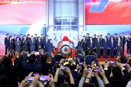 People attend the signing ceremony of the first batch of companies on STAR Market in Shanghai