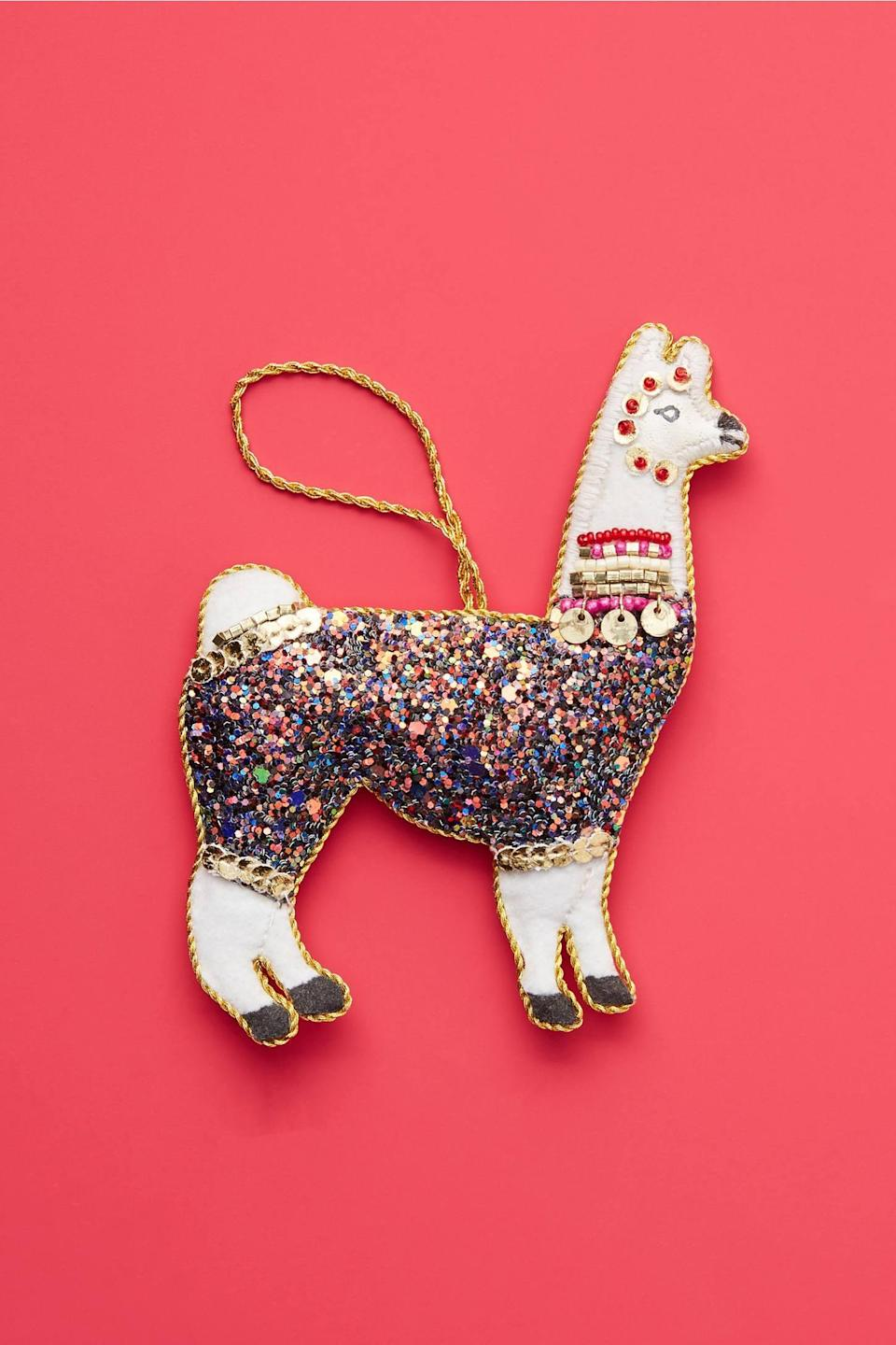 """<p>Give your tree a bit of glitz and glam with the <a href=""""https://www.popsugar.com/buy/Triangle-Bears-Glitter-Llama-Ornament-490437?p_name=Triangle%20of%20Bears%20Glitter%20Llama%20Ornament&retailer=anthropologie.com&pid=490437&price=16&evar1=casa%3Aus&evar9=46615300&evar98=https%3A%2F%2Fwww.popsugar.com%2Fhome%2Fphoto-gallery%2F46615300%2Fimage%2F46615306%2FTriangle-Bears-Glitter-Llama-Ornament&list1=shopping%2Canthropologie%2Choliday%2Cchristmas%2Cchristmas%20decorations%2Choliday%20decor%2Chome%20shopping&prop13=mobile&pdata=1"""" rel=""""nofollow noopener"""" class=""""link rapid-noclick-resp"""" target=""""_blank"""" data-ylk=""""slk:Triangle of Bears Glitter Llama Ornament"""">Triangle of Bears Glitter Llama Ornament</a> ($16).</p>"""