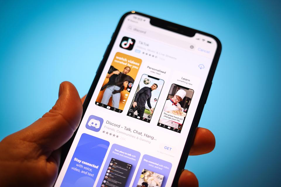 The Discord communications app is seen in the Apple App Store along with the TikTok app in this photo illustration in Warsaw, Poland on April 3, 2021. The communications and messaging platform Discord is reportedly in talks with Microsoft to sell it's platform. According to gaming tech website GamesBeat the sale could result in a USD 10 billion takeover. With over 9 million daily users Discord easily beats workplace messaging app Slack which attracted just over 2 million daily users at it's start. Microsoft could possibly integrate Discord with it's Xbox gaming platform as the app initially became popular with gamers. (Photo by Jaap Arriens/NurPhoto via Getty Images) (Photo: NurPhoto via NurPhoto via Getty Images)