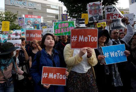 Protesters hold placards during a rally against harassment at Shinjuku shopping and amusement district in Tokyo, Japan, April 28, 2018.   REUTERS/Issei Kato