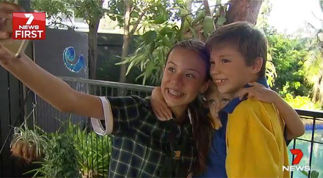 A new study has found kids crowding for selfies increases their chance of getting lice. Source: 7 News