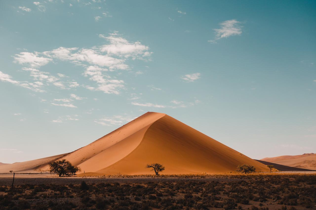 """<p><strong>Average winter temperatures (measured along the coast/Namib Desert):</strong> High of 68 degrees, low of 59 degrees</p> <p>If your idea of a warm vacation involves more <a href=""""https://www.cntraveler.com/story/the-complete-guide-to-safari?mbid=synd_yahoo_rss"""" target=""""_blank"""">safaris</a> than sunbathing, then Namibia is perfect for you. The <a href=""""https://www.cntraveler.com/story/why-your-next-safari-should-be-in-namibia?mbid=synd_yahoo_rss"""">beautiful country</a> has seen a boom in tourism recently, thanks in large part to the fact that it's more accessible than ever. The last few years have seen a proliferation of connecting flights into Windhoek, Namibia's capital, through hubs like <a href=""""https://www.cntraveler.com/story/the-perfect-long-weekend-in-johannesburg-south-africa?mbid=synd_yahoo_rss"""" target=""""_blank"""">Johannesburg</a> on South African Airways, <a href=""""https://www.cntraveler.com/destinations/amsterdam?mbid=synd_yahoo_rss"""">Amsterdam</a> on KLM, <a href=""""https://www.cntraveler.com/story/why-doha-is-much-more-than-a-stopover-destination?mbid=synd_yahoo_rss"""" target=""""_blank"""">Doha</a> on Qatar Airways, and <a href=""""https://www.cntraveler.com/story/go-to-ethiopia-for-ancient-history-jazz-and-a-capital-city-on-the-rise?mbid=synd_yahoo_rss"""">Addis Ababa</a> on Ethiopian Airlines. (Renovated lodges like ultra-luxurious <a href=""""https://www.cntraveler.com/story/first-in-andbeyond-sossusvlei-desert-lodge?mbid=synd_yahoo_rss"""" target=""""_blank"""">AndBeyond Sossusvlei Desert Lodge</a> help, too.) And with some of Africa's most navigable roads, <a href=""""https://www.cntraveler.com/story/namibia-road-trip?mbid=synd_yahoo_rss"""" target=""""_blank"""">road tripping</a> has exploded—especially among millennials eager for Instagram fodder.</p>"""
