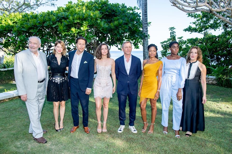 "MONTEGO BAY, JAMAICA - APRIL 25: (L-R) Producer Michael G Wilson with cast members Léa Seydoux, Cary Joji Fukunaga, Ana de Armas, Daniel Craig, Naomie Harris, Lashana Lynch and producer Barbara Broccoli attend the ""Bond 25"" Film Launch at Ian Fleming's Home ""GoldenEye"", on April 25, 2019 in Montego Bay, Jamaica. (Photo by Roy Rochlin/Getty Images for Metro Goldwyn Mayer Pictures)"