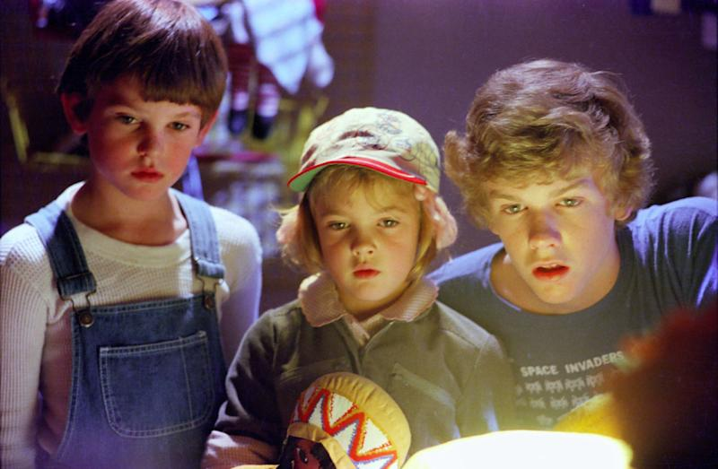 "FILE - This 1982 file photo originally released by Universal Pictures shows actors, from left, Henry Thomas, Drew Barrymore and Robert MacNaughton in a scene from the film, ""E.T.: The Extra- Terrestrial."" It was way back in 1982 when the boy in ""E.T.:The Extra-Terrestrial,"" one of the most beloved family films of all time, called his annoying brother ""penis breath"" _ gaining the instant admiration of legions of fellow youngsters. Only now, a full 30 years later, is the V-word _ vagina _ beginning to surface regularly in mainstream entertainment, popping up in some network TV shows, with references in advertising as well. (AP Photo/Universal Pictures-Amblin Entetainment, Bruce McBroom)"