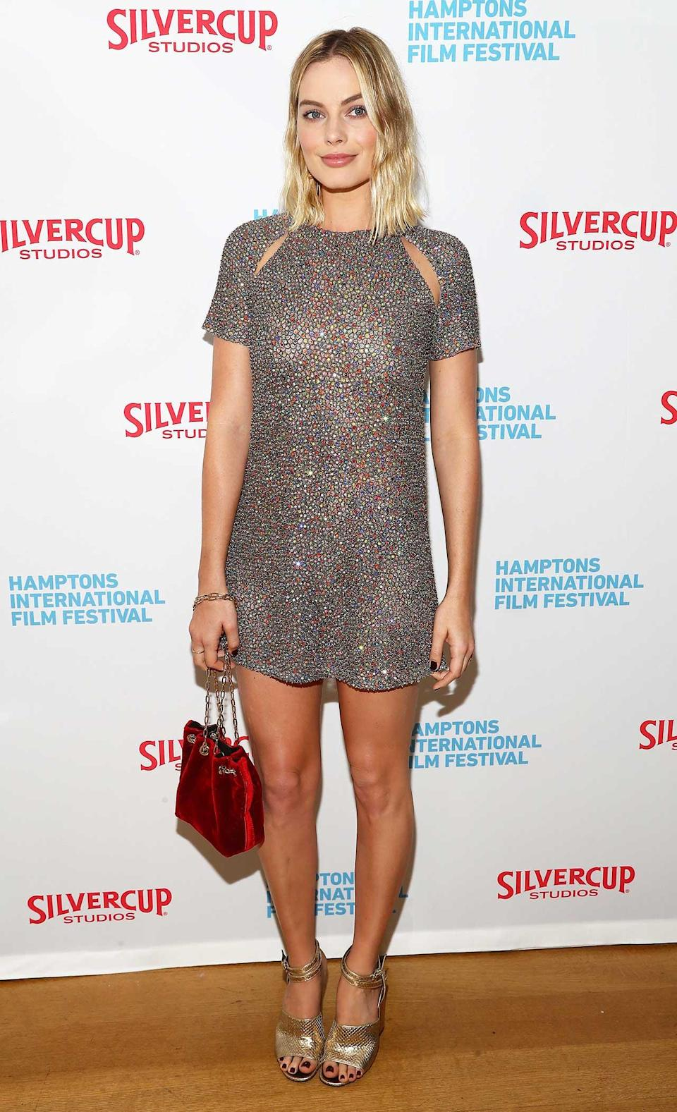 """<h2>In A Dior Dress, Alumnae Heels And A M2Malletier Bag</h2> <p>At the Hamptons International Film Festival, 2017</p> <h4>Getty Images</h4> <p> <strong>Related Articles</strong> <ul> <li><a rel=""""nofollow noopener"""" href=""""http://thezoereport.com/fashion/style-tips/box-of-style-ways-to-wear-cape-trend/?utm_source=yahoo&utm_medium=syndication"""" target=""""_blank"""" data-ylk=""""slk:The Key Styling Piece Your Wardrobe Needs"""" class=""""link rapid-noclick-resp"""">The Key Styling Piece Your Wardrobe Needs</a></li><li><a rel=""""nofollow noopener"""" href=""""http://thezoereport.com/fashion/shopping/everything-need-let-zoe-giveaway/?utm_source=yahoo&utm_medium=syndication"""" target=""""_blank"""" data-ylk=""""slk:Everything You Need From Our Let It Zoe Giveaway"""" class=""""link rapid-noclick-resp"""">Everything You Need From Our Let It Zoe Giveaway</a></li><li><a rel=""""nofollow noopener"""" href=""""http://thezoereport.com/beauty/celebrity-beauty/josephine-skriver-makeup-tutorial-video-vogue/?utm_source=yahoo&utm_medium=syndication"""" target=""""_blank"""" data-ylk=""""slk:A Victoria's Secret Model Shows Us How To Get Our Lips To Her Level"""" class=""""link rapid-noclick-resp"""">A Victoria's Secret Model Shows Us How To Get Our Lips To Her Level</a></li> </ul> </p>"""